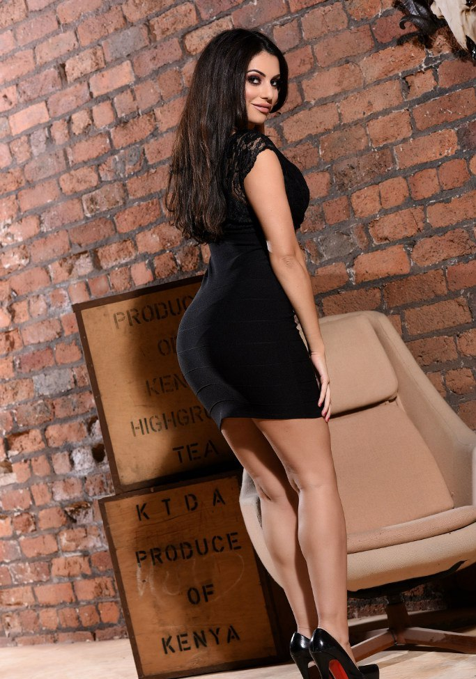 Charlotte Springer in a tight sexy black dress photo-shoot