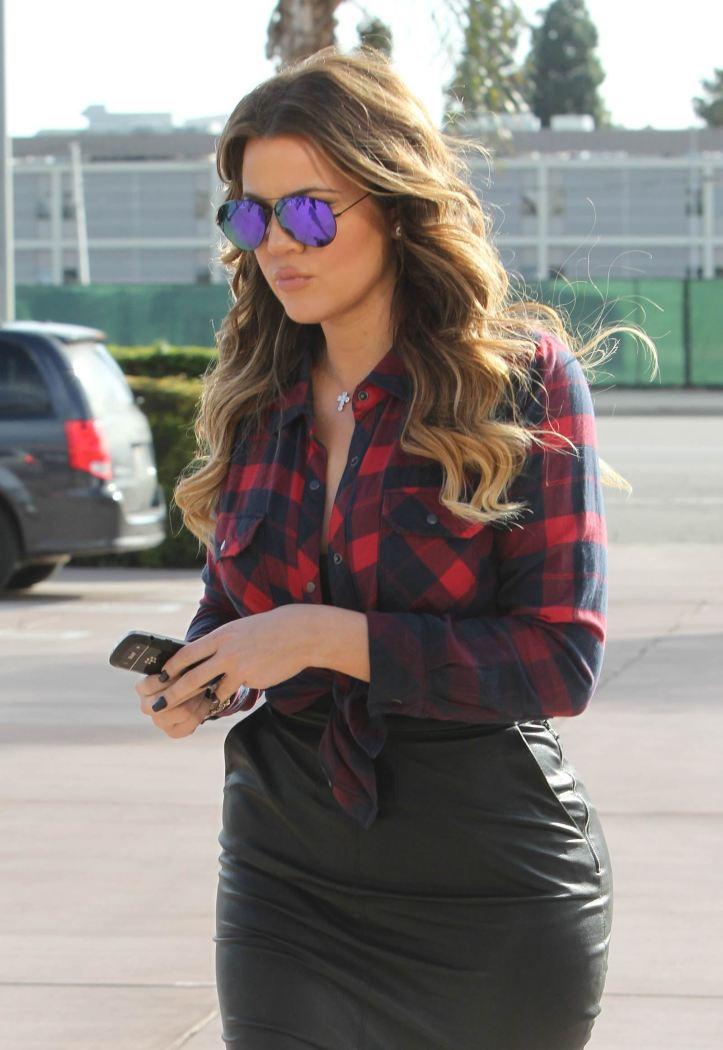 Khloe Kardashian in tight black leather skirt while filming in Calabasas