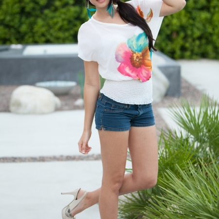 Natasha Belle posing in tight jeans and white tops